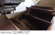 Купить «black tea moving on machine conveyor at factory», видеоролик № 22483127, снято 17 февраля 2016 г. (c) Syda Productions / Фотобанк Лори