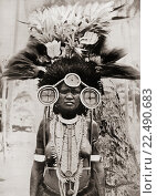 Купить «A woman of the Roro tribe from Papua New Guinea, Melanesia, decorated for a ceremonial dance. After a 19th century photograph. From Customs of The World, published c. 1913.», фото № 22490683, снято 22 октября 2019 г. (c) age Fotostock / Фотобанк Лори