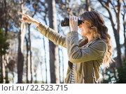 Купить «Woman using binoculars», фото № 22523715, снято 1 октября 2015 г. (c) Wavebreak Media / Фотобанк Лори