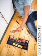 Купить «Man repairing a kitchen sink», фото № 22526715, снято 15 декабря 2015 г. (c) Wavebreak Media / Фотобанк Лори