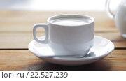 Купить «full cup of coffee on wooden table», видеоролик № 22527239, снято 2 апреля 2016 г. (c) Syda Productions / Фотобанк Лори