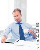 Купить «businessman with tablet pc and coffee in office», фото № 22528183, снято 9 июня 2013 г. (c) Syda Productions / Фотобанк Лори