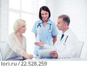Купить «doctor and nurse with patient in hospital», фото № 22528259, снято 6 июля 2013 г. (c) Syda Productions / Фотобанк Лори