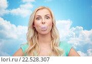 Купить «happy young woman or teenage girl chewing gum», фото № 22528307, снято 13 февраля 2016 г. (c) Syda Productions / Фотобанк Лори