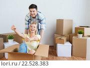 Купить «happy couple having fun with boxes at new home», фото № 22528383, снято 25 февраля 2016 г. (c) Syda Productions / Фотобанк Лори