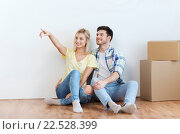 Купить «couple with boxes moving to new home and dreaming», фото № 22528399, снято 25 февраля 2016 г. (c) Syda Productions / Фотобанк Лори