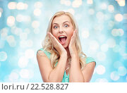 Купить «surprised smiling young woman or teenage girl», фото № 22528827, снято 13 февраля 2016 г. (c) Syda Productions / Фотобанк Лори