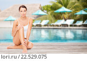 Купить «beautiful young woman over beach swimming pool», фото № 22529075, снято 25 июля 2013 г. (c) Syda Productions / Фотобанк Лори