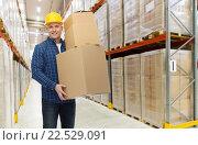 Купить «happy man or loader with box at warehouse», фото № 22529091, снято 7 марта 2015 г. (c) Syda Productions / Фотобанк Лори