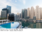 Купить «Dubai city seafront with hotel infinity edge pool», фото № 22529223, снято 24 февраля 2016 г. (c) Syda Productions / Фотобанк Лори