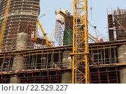 Купить «building of skyscraper in Dubai city», фото № 22529227, снято 25 февраля 2016 г. (c) Syda Productions / Фотобанк Лори