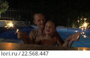 Купить «Woman and Boy with Sparklers in Pool», видеоролик № 22568447, снято 4 февраля 2016 г. (c) Данил Руденко / Фотобанк Лори