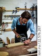 Купить «Carpenter working on his craft», фото № 22576267, снято 14 февраля 2016 г. (c) Wavebreak Media / Фотобанк Лори