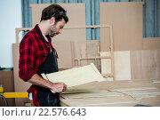 Carpenter working on his craft. Стоковое фото, агентство Wavebreak Media / Фотобанк Лори