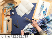 Купить «Table of skilled tailors working», фото № 22582719, снято 24 марта 2016 г. (c) Владимир Мельников / Фотобанк Лори