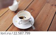 Купить «hand dropping sugar into coffee cup on table», видеоролик № 22587799, снято 2 апреля 2016 г. (c) Syda Productions / Фотобанк Лори
