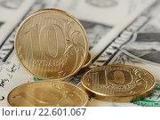 Купить «Монеты десять рублей лежат на банкноте один доллар», эксклюзивное фото № 22601067, снято 11 апреля 2016 г. (c) Юрий Морозов / Фотобанк Лори