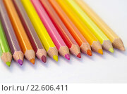 Купить «Цветные карандаши на белой бумаге крупным планом», фото № 22606411, снято 17 апреля 2016 г. (c) Елена Коромыслова / Фотобанк Лори