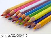 Купить «Цветные карандаши на белой бумаге крупным планом», фото № 22606415, снято 17 апреля 2016 г. (c) Елена Коромыслова / Фотобанк Лори