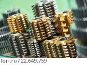 Купить «hobbing cutter with coating for cog wheels gears machining», фото № 22649759, снято 18 мая 2015 г. (c) Дмитрий Калиновский / Фотобанк Лори