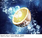 Купить «Juicy orange in water», фото № 22662291, снято 25 июня 2019 г. (c) Sergey Nivens / Фотобанк Лори