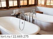 Купить «close up of bathroom with two bathtubs», фото № 22669275, снято 16 февраля 2016 г. (c) Syda Productions / Фотобанк Лори