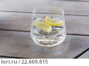 Купить «glass of sparkling water with lemon on table», фото № 22669815, снято 11 февраля 2016 г. (c) Syda Productions / Фотобанк Лори