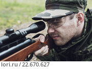 Купить «close up of soldier or hunter with gun in forest», фото № 22670627, снято 14 августа 2014 г. (c) Syda Productions / Фотобанк Лори