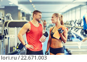 smiling man and woman talking in gym. Стоковое фото, фотограф Syda Productions / Фотобанк Лори