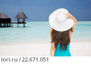 woman in swimsuit and sun hat from back on beach. Стоковое фото, фотограф Syda Productions / Фотобанк Лори