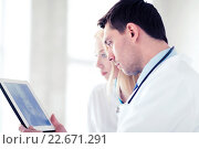 Купить «two doctors looking at x-ray on tablet pc», фото № 22671291, снято 18 мая 2013 г. (c) Syda Productions / Фотобанк Лори