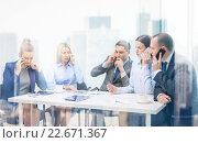 Купить «business team with smartphones having conversation», фото № 22671367, снято 9 ноября 2013 г. (c) Syda Productions / Фотобанк Лори