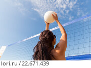 Купить «young woman with ball playing volleyball on beach», фото № 22671439, снято 6 августа 2015 г. (c) Syda Productions / Фотобанк Лори