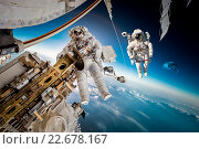 Купить «International Space Station and astronaut.», фото № 22678167, снято 21 декабря 2015 г. (c) Андрей Армягов / Фотобанк Лори