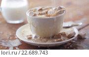 Купить «coffee and sugar falling to cup on table», видеоролик № 22689743, снято 15 апреля 2016 г. (c) Syda Productions / Фотобанк Лори