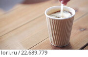 Купить «hand adding and stirring sugar in cup of coffee», видеоролик № 22689779, снято 15 апреля 2016 г. (c) Syda Productions / Фотобанк Лори