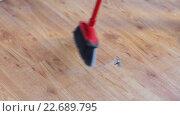 Купить «woman with broom cleaning floor at home», видеоролик № 22689795, снято 17 апреля 2016 г. (c) Syda Productions / Фотобанк Лори