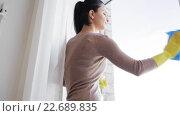 Купить «woman in gloves cleaning window with rag», видеоролик № 22689835, снято 16 апреля 2016 г. (c) Syda Productions / Фотобанк Лори