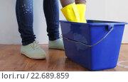 Купить «woman washing and squeezing rag in bucket at home», видеоролик № 22689859, снято 17 апреля 2016 г. (c) Syda Productions / Фотобанк Лори