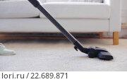 Купить «woman with vacuum cleaner cleaning carpet at home», видеоролик № 22689871, снято 17 апреля 2016 г. (c) Syda Productions / Фотобанк Лори