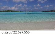Купить «blue sea lagoon with swing on maldives beach», видеоролик № 22697555, снято 12 февраля 2016 г. (c) Syda Productions / Фотобанк Лори