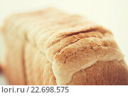 Купить «close up of white toast bread», фото № 22698575, снято 22 мая 2015 г. (c) Syda Productions / Фотобанк Лори