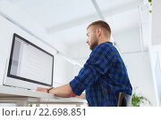 Купить «creative man or programmer with computer at office», фото № 22698851, снято 27 февраля 2016 г. (c) Syda Productions / Фотобанк Лори