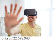 Купить «young man in virtual reality headset or 3d glasses», фото № 22698943, снято 12 марта 2016 г. (c) Syda Productions / Фотобанк Лори