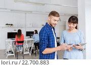Купить «couple with smartphone and tablet pc at office», фото № 22700883, снято 27 февраля 2016 г. (c) Syda Productions / Фотобанк Лори