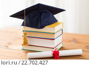 close up of books with diploma and mortarboard. Стоковое фото, фотограф Syda Productions / Фотобанк Лори