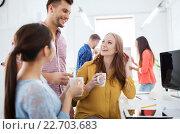 Купить «happy creative team drinking coffee at office», фото № 22703683, снято 27 февраля 2016 г. (c) Syda Productions / Фотобанк Лори