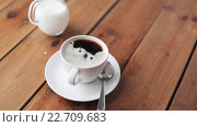 Купить «sugar falling into cup of coffee on wooden table», видеоролик № 22709683, снято 2 апреля 2016 г. (c) Syda Productions / Фотобанк Лори