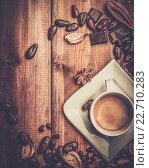 Купить «Coffee cup on a wooden table among coffee beans», фото № 22710283, снято 21 января 2014 г. (c) Andrejs Pidjass / Фотобанк Лори