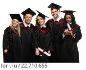 Купить «Multi ethnic group of graduated young students isolated on white», фото № 22710655, снято 24 апреля 2014 г. (c) Andrejs Pidjass / Фотобанк Лори